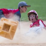 Montgomery County Little League's Calvin Tamulonis watches second base fly into the air after he slide in safely under the tag of Jordan Zamana of Mountain Valley in a semifinal game Wednesday in Myersville.